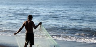 Fisherman on the black sands of Monterrico