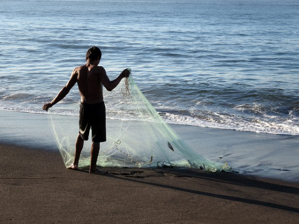 Fisherman on the black sands of Monterrico