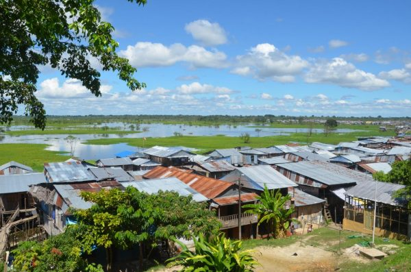 Houses next to water in Iquitos, Peru