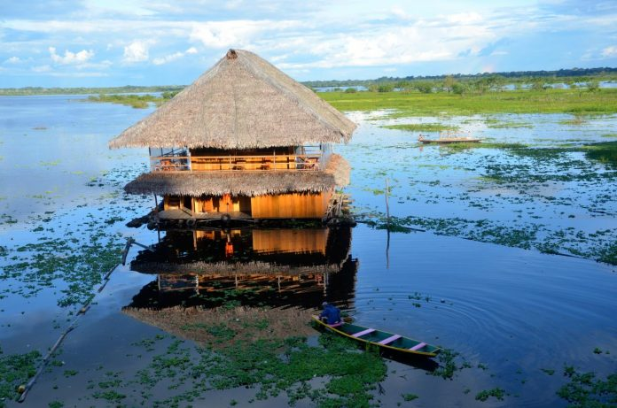 A hut standing above the water in Iquitos, Peru